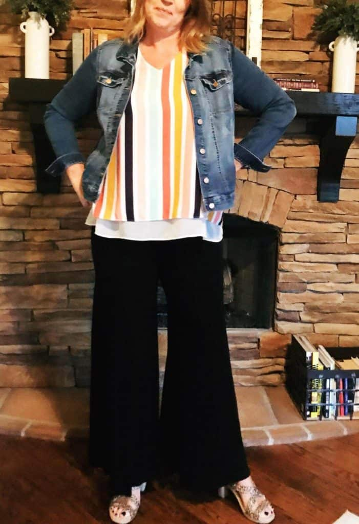 Denim jacket, striped blouse and black palazzo pants long length.