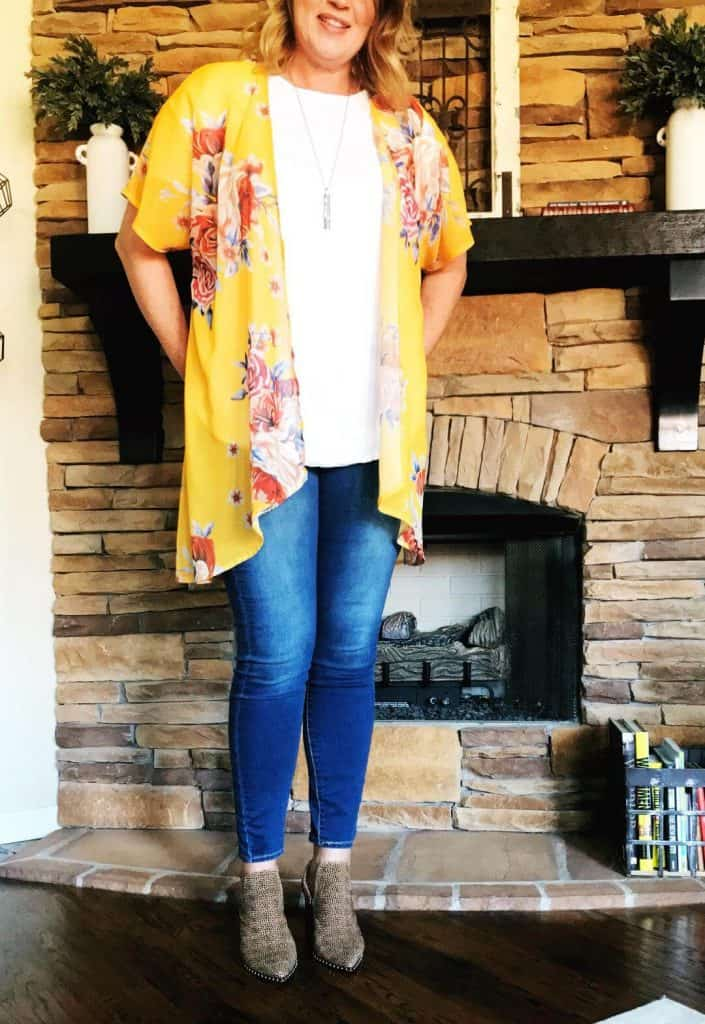 Yellow floral kimono, skinny jeans in long length, and cheetah boots.